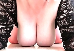 Mature milf in red stockings jumps on a big dildo, close-up of a big butt.