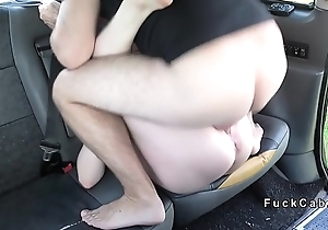 Redhead pissing in front of taxi driver
