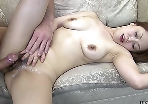 She is still twitching when he cums on her hairy pussy