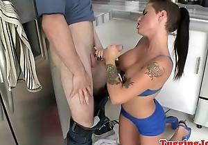 Inked stunner tugging dick in the kitchen
