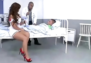 Hot nurse taking two cocks