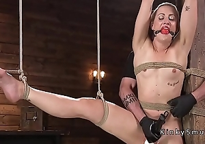 Blonde in extreme rope bondage suspension